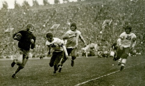 Southern Cal quarterback Don Williams carrying the ball, 1928