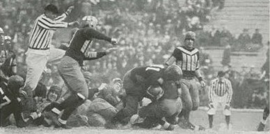 Utah carrying the ball against Utah State in a 1930 football game