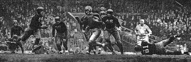 Oregon State carrying against Fordham in 1933