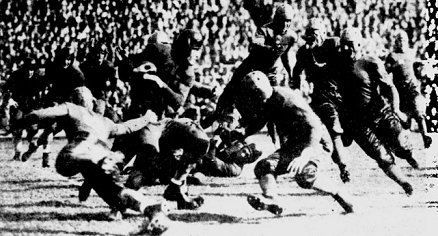 Minnesota halfback Pug Lund carrying against Pittsburgh in 1934