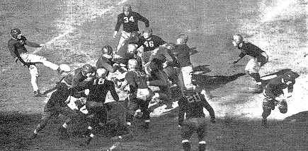 Pittsburgh halfback Marshall Goldberg punting against Fordham in 1936