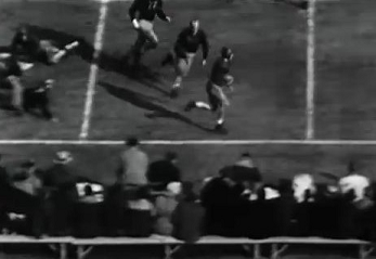 Pittsburgh halfback Marshall Goldberg carrying for a 22 yard gain against Washington in the 1937 Rose Bowl