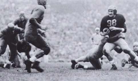 Michigan halfback Tom Harmon carrying against Minnesota in 1940