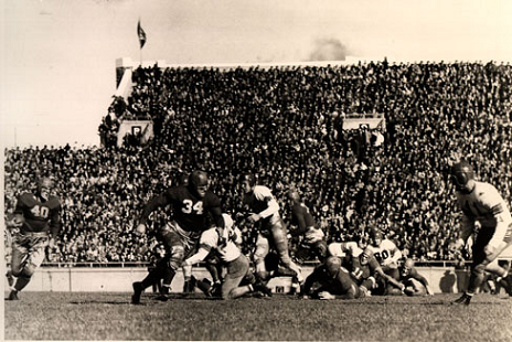Wisconsin back Crazy Legs Hirsch carrying against Ohio State in a 1942 football game