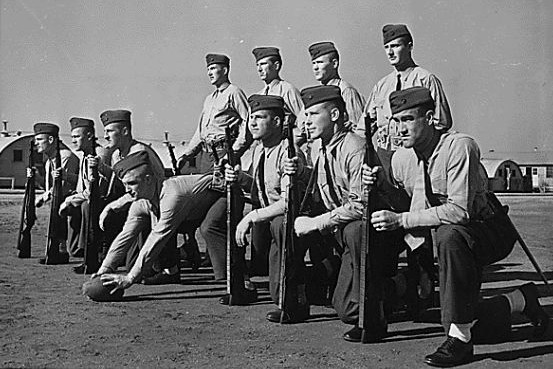11 former college football player Marines at boot camp in 1943