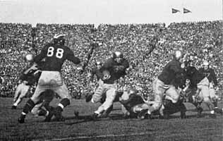 1943 Notre Dame - Michigan football game, Jim Mello carrying the ball for Notre Dame