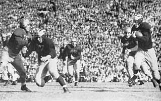 1943 Michigan - Notre Dame football game, Elroy Hirsch carrying for Michigan