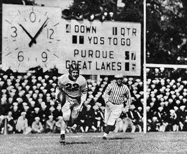 Purdue returning the ball in a 1943 game against Great Lakes Navy