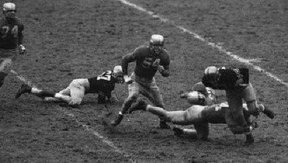 Notre Dame tackling Army ball carrier in 1946