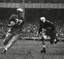 Notre Dame halfback Terry Brennan carrying the ball against Army in 1946