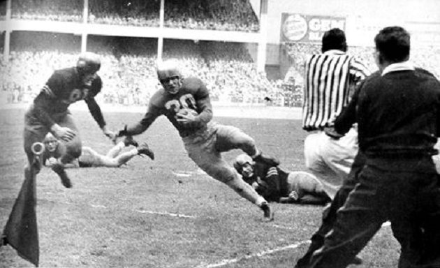 Notre Dame's Bill Gompers about to be stopped short on a 4th down run near the goal line in the 1946 game against Army