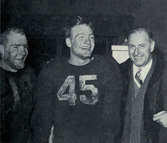 Michigan's Bump Elliott, Pete Elliott, and Fritz Crisler celebrate winning the Big 9 after defeating Wisconsin in 1947