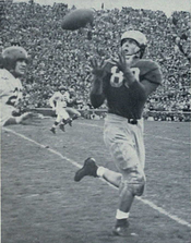 Michigan end Dick Rifenburg catching a pass against Indiana in 1947
