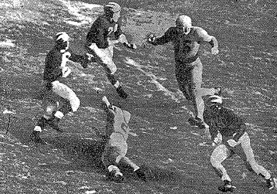 Michigan halfback Bob Chappuis carrying the ball against Minnesota in 1947