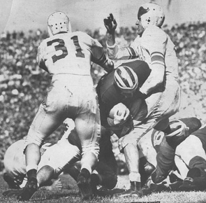 Michigan halfback Bob Chappuis carrying against Michigan State in 1947