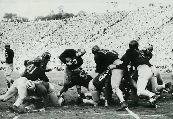 Michigan fullback Jack Weisenbuger scoring a touchdown against Southern Cal in the 1948 Rose Bowl