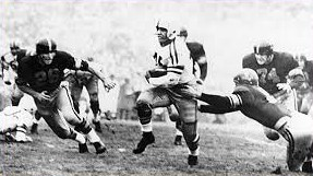 Ohio State halfback Bobby Watkins scoring a touchdown against USC in the 1955 Rose Bowl