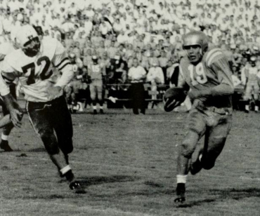 UCLA halfback Primo Villanueva scoring a touchdown against Stanford in 1954