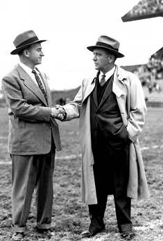 Coaches John Cherberg and Red Sanders shake hands after 1954 Washington-UCLA football game