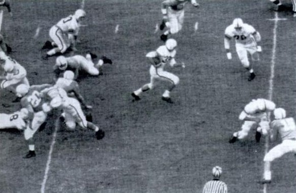 Auburn fullback Billy Atkins carrying the ball against Tennessee in 1957