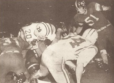 Halfback Billy Cannon carrying the ball for LSU against Rice in 1958