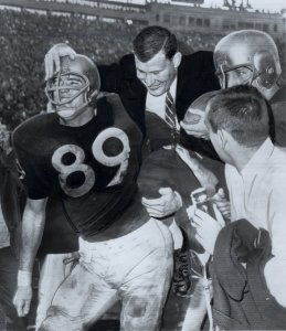 Washington players carry coach Jim Owens off the field after the 1961 Rose Bowl