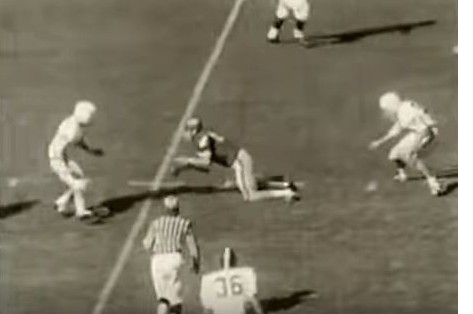 "Georgia receiver lateraling in their 1965 ""flea-flicker"" play against Alabama, knees already down"