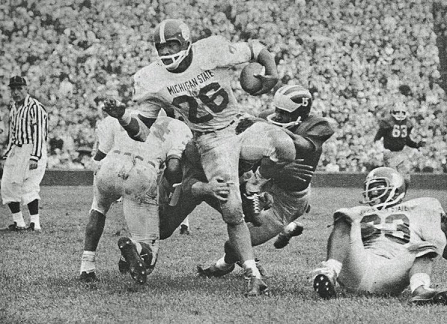Michigan State running back Clint Jones carrying against Michigan in 1965