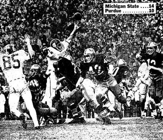 Purdue quarterback Bob Griese completing a pass against Michigan State in 1965