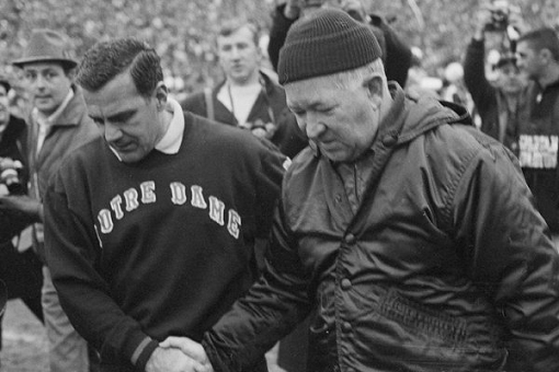 Notre Dame coach Ara Parseghian and Michigan State coach Duffy Daugherty shake hands after their 10-10 tie in 1966