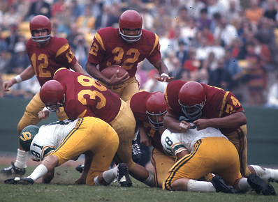 Southern Cal running back O. J. Simpson carrying the ball against Oregon in 1967