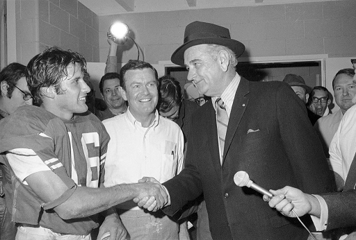 Former president Lyndon Johnson congratulates Texas after their win over Notre Dame in the 1970 Cotton Bowl