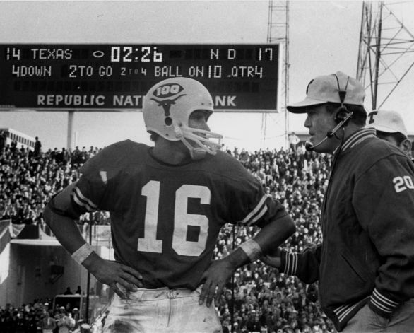 Texas coach Darrell Royal conferring with quarterback James Street before the biggest play in the 1970 Cotton Bowl