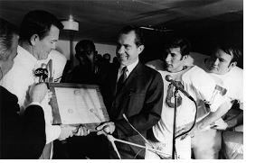 President Nixon handing Texas coach Darrell Royal a plaque declaring his team the national champion of 1969